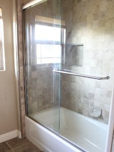 Nice tub/shower combo in upstairs shared bathroom