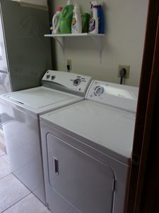 Unit includes a new full size washer and drier in a seperate laundry room