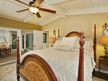 "Master Suite with 46"" Flat Screen TV and access to Courtyard and Backyard"