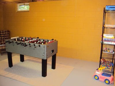 Game room in basement including foosball and games.