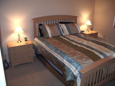 Queen size bed with TV and DVD player