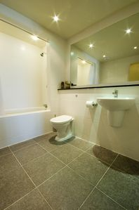 Huge main en-suite bathroom with granite