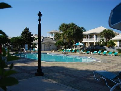 Emerald Shores main pool with large sundeck is beautifully landscaped