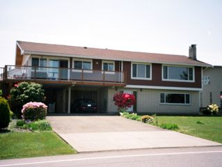 Nanaimo apartment photo - front of house with suite on ground floor level