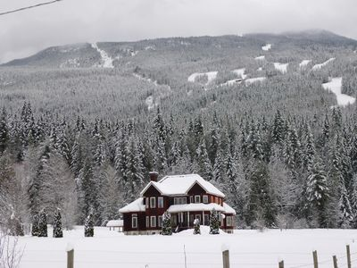 Winter view of Catherwood Lodge with runs of RMR above