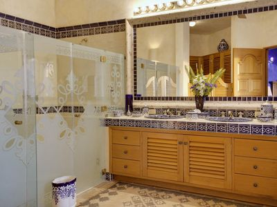 The Master bedroom en suite bathroom with etched glass and hand painted tiles.