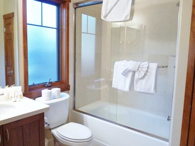 Guest Room Baths with Toiletries, Fluffy Towels, Tub & Shower