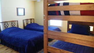 Orleans house photo - Bedroom # 3 has 4 twin beds, Two are single and 1 set of bunk beds on 1st floor.