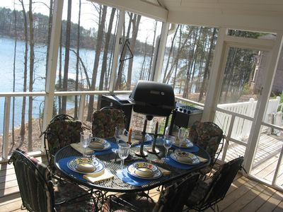 Screened porch off dining area with open deck beyond