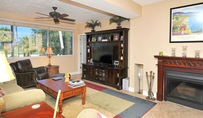 Living area with entertainment center and fireplace