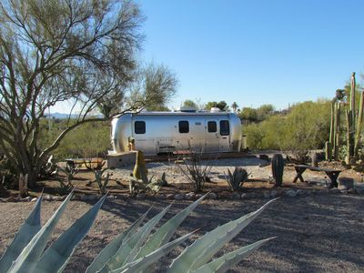 Exterior of Airstream trailer with wood deck and Catalina granite patio.