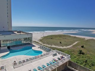 Sands Beach Club condo photo - One of two outdoor pools and a indoor pool is located behind the glass windows.