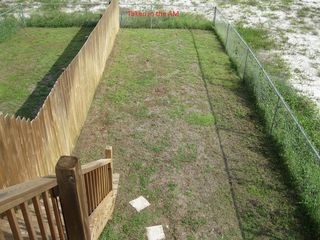 Gulf Shores house photo - Upstairs view of Fenced Yard.