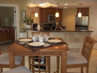 Palmetto Dunes condo photo - Pub Table with 4 chairs. Can you see the wine rack? Breakfast bar in background.