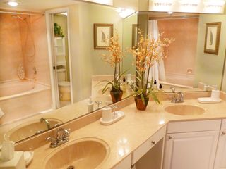 Hutchinson Island condo photo - On-suite master bath with two sinks and separate toilet area
