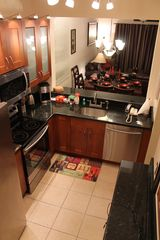 Regal Palms villa photo - Granite Countertops, Stainless Steel Appliances, Gourmet Galley Kitchen, Bar