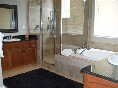 Travertine Tile, His & Her Sinks, Jetted Tub & Oversized Custom Shower.