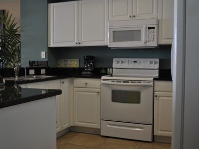 Fully Equipped Kitchen open to Family Room and view