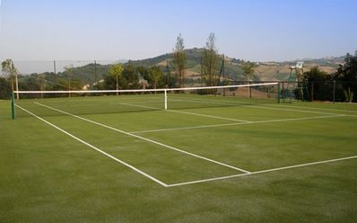 National size tennis court with all weather surface