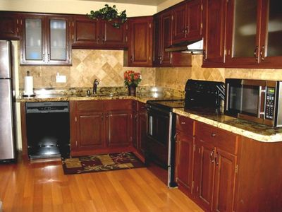 KITCHEN: Granite countertops. Beautiful stone accents. Dining area.