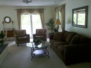 Traverse City house photo - Living room, natural fireplace, bay window, cable tv/dvd, queen sleeper sofa