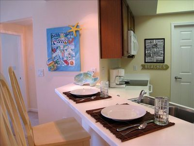 Silver Beach Towers Resort condo rental - Dining Bar Looks Into the Kitchen & Seats Two
