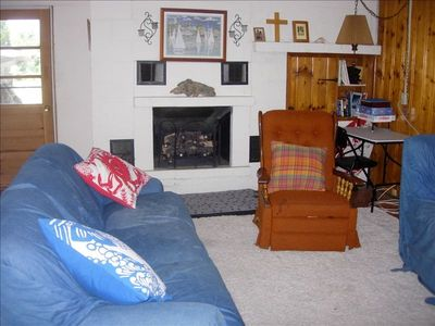 "Living Room - Has a 63"" TV, DirecTV including NFL ticket. Sleep 1 on couch."
