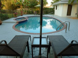 Boca Raton villa photo - Relax Pool Side at Dolphin Retreat - heated pool and spa.
