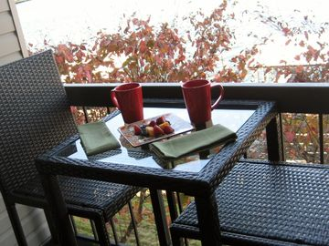 Enjoy your morning coffee on the kitchen balcony.