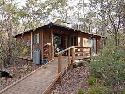 Jemby Rinjah Eco Cabin 2 is a two story cabin suitable for singles and couple with 1 Queen and 4 single beds, the tounge and kitchen are on ground floor bathroom on the landing and bedrooms upstairs amongst the treetops