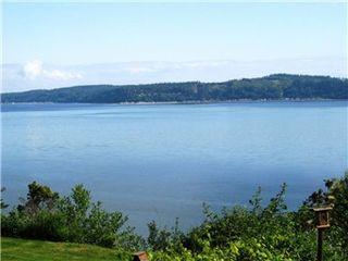 Camano Island house photo - View from deck that wraps around most of the home with sliding glass doors.
