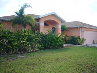 Cape Coral house photo - lush plantings, front porch