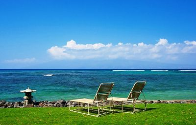 View of the ocean and islands of Lanai & Molokai from lawn area fronting seawall