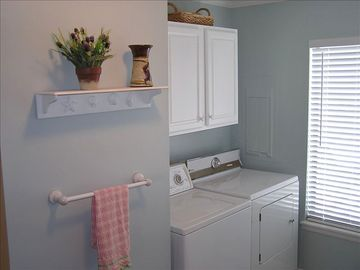 Laundry area offers full size washer and dryer in our condo.