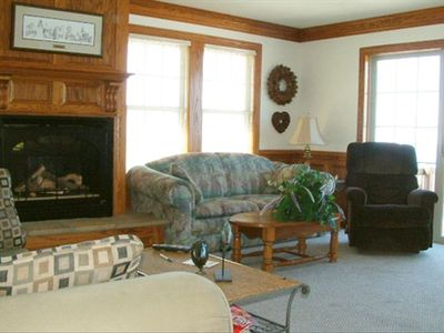 Comfy and spacious living space, a gas fireplace and open views to the water.