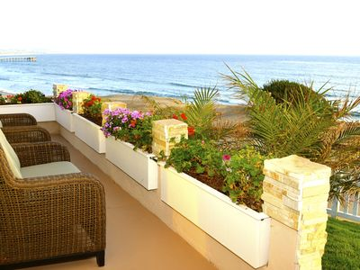 Relax and enjoy the amazing ocean view and sunsets from the front yard.