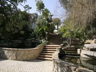 Alvor farmhouse photo - Entrance stairs from parking up towards main house with water fall.