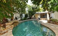 Just steps to the beach with a private heated pool!!!