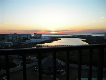 Balcony sunsets with $1.5+ million villas on right & Gulf view in center