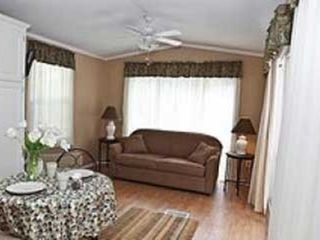 Flat Rock cottage photo - Relaxing living room with cable tv and sofa bed. Ceiling fan and air conditioned