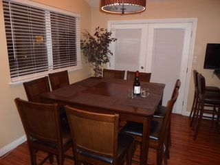 Las Vegas house photo - Dining area table and 8 chairs. French doors to deck.