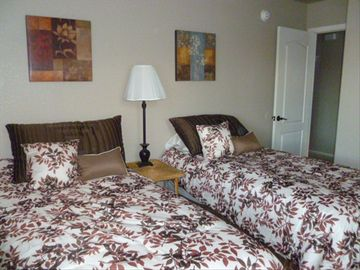 Guestroom with two twin beds, large double closet. Beds can be made into king.