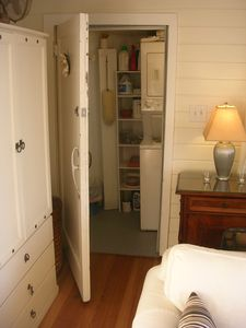 Beach Bungalow: Storage room off living area includes washer/dryer.