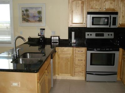 Updated kitchen w/ granite and real wood cabinets, new appliances.