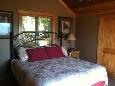 Gatlinburg chalet rental - Bedroom 2 on main level with bathroom and access to deck and view of mountains