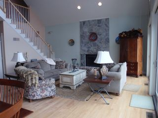 Lake Winnisquam house photo - living room and 2cd floor staircase