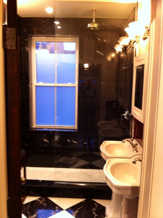 Bathroom - double pedestal sinks and large marble walk in shower with rain head