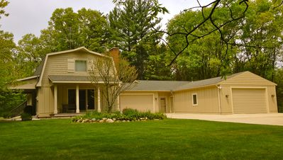 nestled on 6 acres of rolling wooded hills / 10 min. to Down Town Grand Rapids.