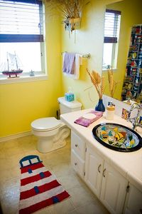 "One of the ""beachy"" right down to the sink/faucet bathrooms"