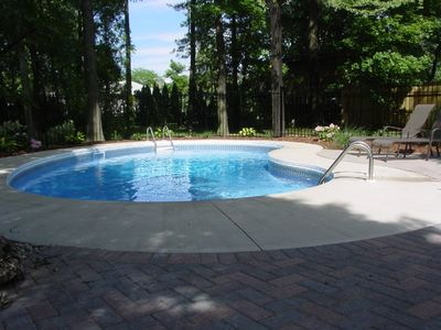 Heated kidney shaped pool surrounded by patio